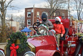 """The Truro Fire Service allowed visitors to sit on """"Nancy,"""" a 1919 American LaFrance fire truck. The seat was sanitized after each use."""