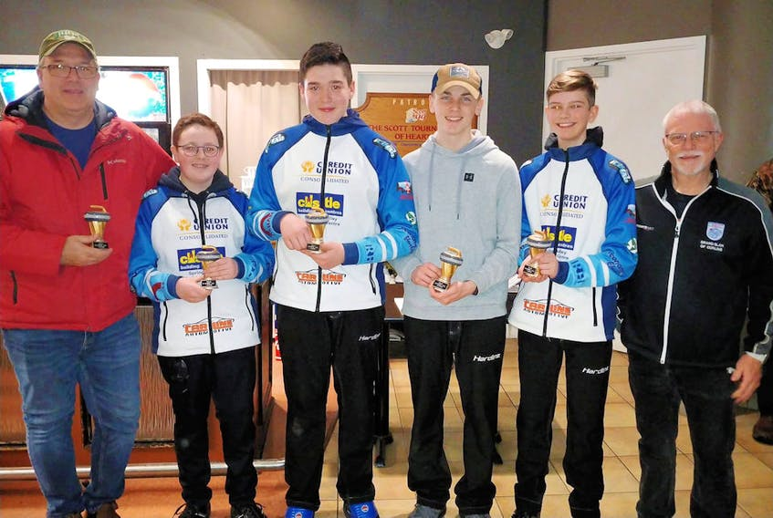 Curl P.E.I. vice-president Craig Mackie, right, congratulates members of the Brayden Snow-skipped rink from the host Charlottetown Curling Club on winning the A Division of the .E.I. under-16 curling championships on Sunday. Team members are, from left: David MacFadyen (coach), Snow, third stone Jack MacFadyen, second stone Cruz Pineau and lead Davis Nicholson.