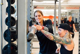 Two-time Canadian Olympic snowboarder Sarah Conrad, left, is now a strength and conditioning specialist at the Canadian Sport Centre Atlantic. Conrad is showing working with para athlete Erin Saari. Lyndsay Doyle