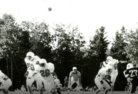 UCCB Capers player Mark Pearce, right, delivers a punt during an Atlantic Universities Athletic Association game against Mount Allison during the 1990 football season at the Canadian Coast Guard College in Westmount. Today, after a short professional playing career, Pearce owns his own blacksmith business in Calgary, Alta. CONTRIBUTED