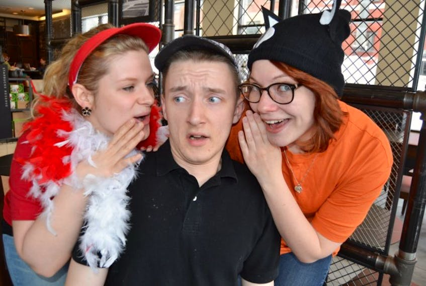 """<p><span class=""""Normal"""">GUARDIAN PHOTO BY SALLY COLE</span></p> <p><span class=""""Normal"""">Ugly (Jacob Durdan) gets advice from his new friends, Rooster (Kaitlyn Post), left, and Cat (Becca Griffin) , in a rehearsal scene from The Ugly Duckling. After a snow cancellation, last month, the show is back on the boards of The Guild in Charlottetown on March 21 at 12 and 2:30 p.m.</span></p>"""