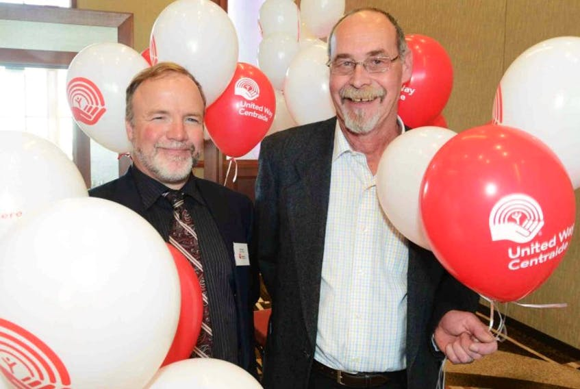 """<span class=""""Normal"""">Tim Collette, right, says he can't thank the Victorian Order of Nurses program enough for what they did for he and his wife, Gail, after she was diagnosed with Alzheimer's disease. The program receives funding from the United Way of P.E.I., which launched its campaign kickoff in Charlottetown on Thursday. Doug Burton, president of the United Way, says their goal is to raise close to $1 million this year. <br /></span>"""