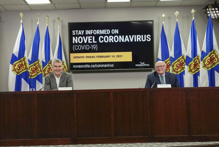 Premier Stephen McNeil and Dr. Robert Strang, Nova Scotia's chief medical officer of health, at a COVID-19 news briefing in Halifax on Friday.