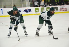 Jason Simmonds/Journal Pioneer UPEI Panthers defenceman Tanner McCabe, left, and right-winger TJ Shea line up for a faceoff during an Atlantic University Sport men's hockey game at MacLauchlan Arena earlier this season. McCabe and Shea are both graduates of the Summerside Western Capitals' junior A hockey program. UPEI opens the Atlantic University Sport playoffs at Saint Mary's on Wednesday night.