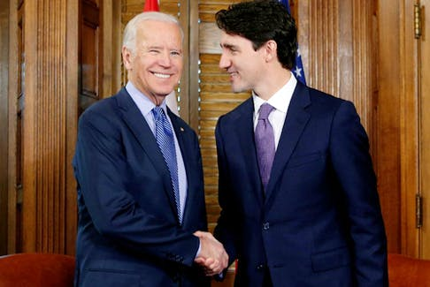Canada's prime minister, Justin Trudeau (R), shakes hands with then-U.S. Vice President Joe Biden during a meeting in Trudeau's office on Parliament Hill in Ottawa, Ontario, Canada, December 9, 2016.