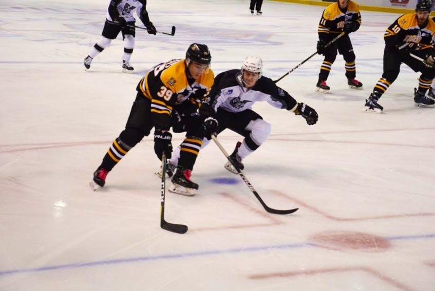 The Valley Wildcats' Adam Nolan defends against Luc Arsenault of the Campbellton Tigers during first-period action in Wednesday afternoon's game at the MHL (Maritime Junior Hockey League) Showcase in Summerside. The Wildcats prevailed 4-1.