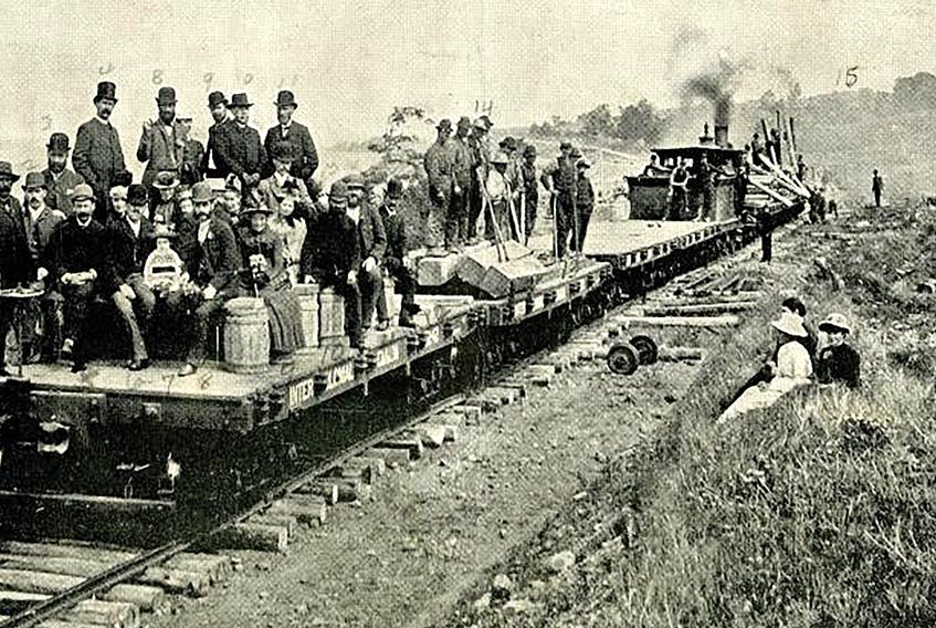 An open passenger car as part of the first train to cross the Grand Narrows Bridge. First Train Across Grand Narrows Bridge, ca 1890. CONTRIBUTED/77-847-981, Beaton Institute, CBU