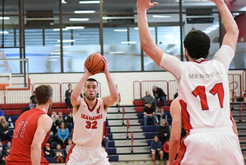 Vasilije Curcic (32) of the Memorial Sea-Hawks looks to make a pass to teammate Jacob Hynes (11) during Atlantic University Sport (AUS) men's basketball action at Acadia University in Wolfville, N.S., over the weekend. The Sea-Hawks finished their 2016-17 AUS regular-season by splitting two games with the Axemen. Fourth-place Memorial will take on fifth-place Acadia in a playoff quarter-final matchup next weekend in Halifax. Saturday's game against Acadia was the final regular-season contest for Curcic, who finished second in AUS scoring this season and as Memorial's third-leading scorer of all time.