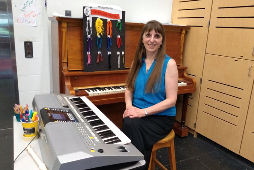 Long-time Kings County music educator Donna Rhodenizer retires this month from a 35-year teaching career. Rhodenzer, shown here in her classroom at KCA in Kentville, plans to keep busy writing and arranging music and performing as part of the duo Donna & Andy.