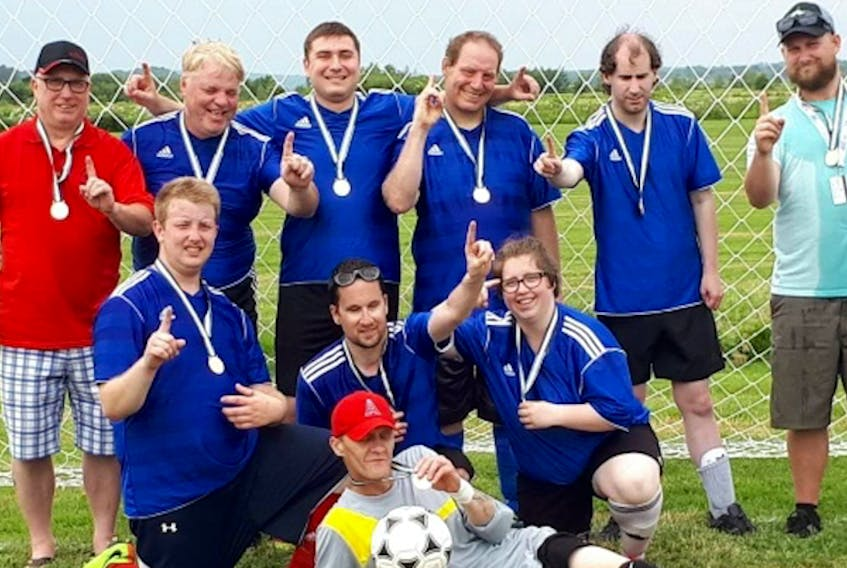 Scott Weir, second from the right standing, scored a goal in his first Summer Games for Special Olympics as a soccer player. His team, from Kings Special Olympics, won the gold medal.