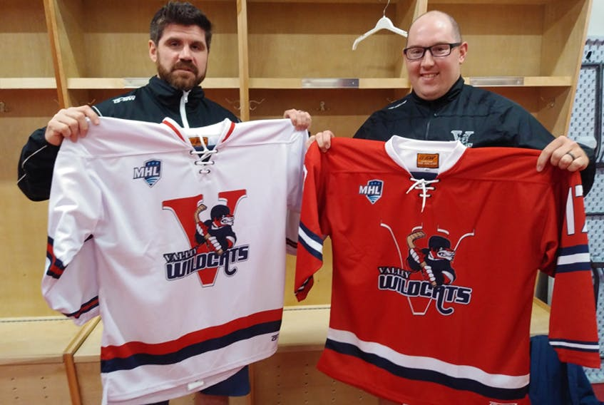Valley Wildcats head coach Brandon Benedict, left, and assistant coach Nick Croft show off the new jerseys for the Junior A club.