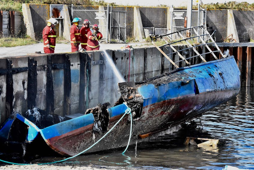 A boat belonging to a member of the Sipekne'katik First Nation was heavily damaged in a suspected arson in October 2020 at the Comeauville wharf. -  Tina Comeau / File