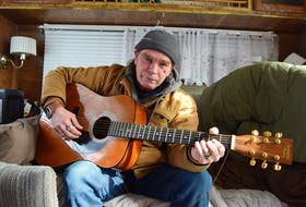 Glen Forrest of Sydney Mines with his beloved guitar, in a dilapidated camper he lives in without water, heat or sewer, on his property. Forrest, homeless since his home burned down seven years ago, admits he is suffering and wants a warm place to call home on his own land. Sharon Montgomery-Dupe/Cape Breton Post