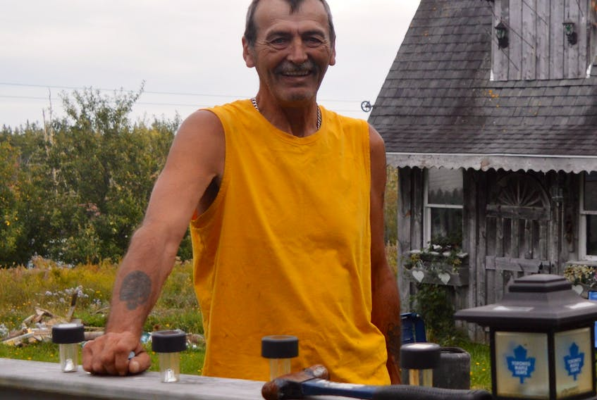 """CBRM mayoral candidate Archie MacKinnon, shown here in the backyard of his Little Bras d'Or residence, calls himself the """"people's champion."""" DAVID JALA/CAPE BRETON POST"""