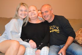 Haley Toomey, left, 23, with her parents Cayla Toomey and Tim Toomey at their home in Glace Bay, sharing incredible news that a tumour in Cayla's brain is shrinking. The family say they will be taking part in the Cape Breton Regional Hospital Foundation RadioDay fundraiser being held at Centre 200 in Sydney on Thursday. Sharon Montgomery-Dupe/Cape Breton Post