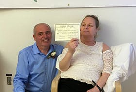 Tim Toomey, 54, and Cayla (Gouthro) Toomey, 51, of Glace Bay, proudly show their wedding certificate after getting married May 27 at the Cape Breton Regional Hospital in Sydney. The couple were together on and off for 30 years but ended back together permanently 10 years ago. CONTRIBUTED