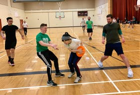 Mandy Mo catches the disc in the end zone for a point during a game of Ultimate Frisbee at Brookland Elementary School gym in Sydney Wednesday night. Looking on from left are fellow Sport and Social Club of CBRM members, from left, Eric Lee, B.J. Johnston and Jean-Luc Pinsent. Chris Connors • Cape Breton Post