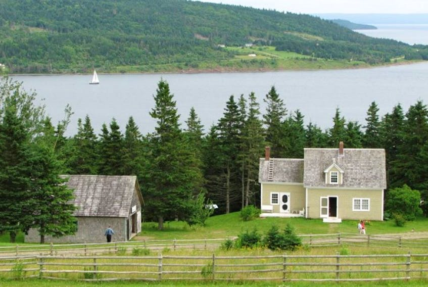 The Macivor-Nash house, built around 1900, is the latest style of Cape Breton home at the Highland Village Museum. The shoreline of Grand Narrows is visible on the other side of the Barra Strait.