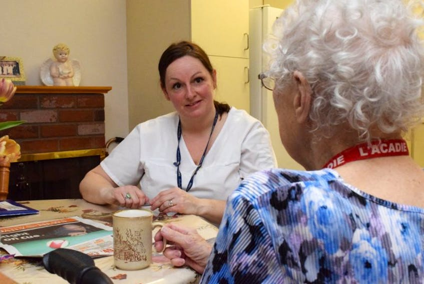 <p>Betty Perrin talks with VON Colchester East Hants continuing care assistant Vanessa Campbell during a morning home care visit. Perrin has three home visits each day through the VON, all helping with daily tasks and meal preparation.</p>