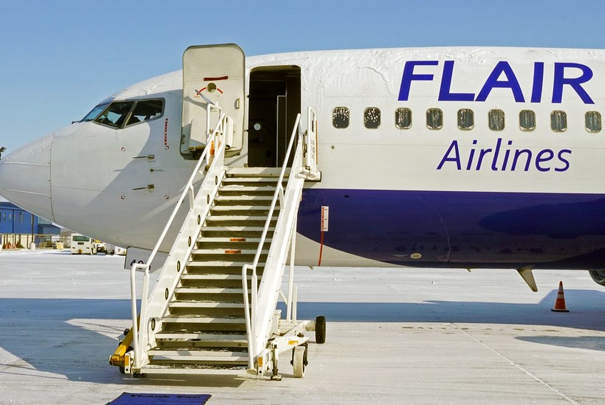 Flair Airlines Boeing 737-400 aircraft at Edmonton International Airport.