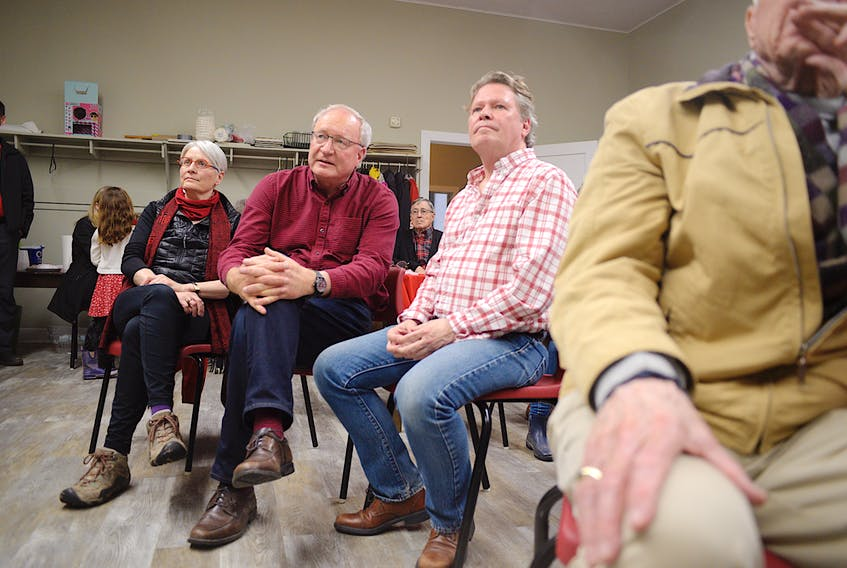 P.E.I. Liberal Leader Wade MacLauchlan, centre, and his partner Duncan McIntosh watch election results roll in at Stanhope Place on Tuesday, April 23. - Nathan Rochford