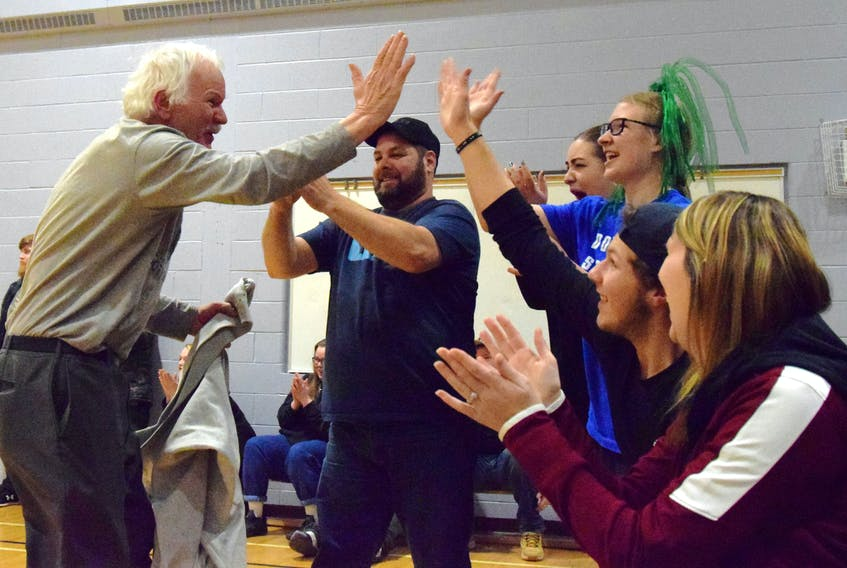 Walter Nickerson celebrates with fellow fans and parents when the Lockeport Greenwave senior girls' team won the NSSAF Division 3 regional championships on Feb. 22 in Shelburne. KATHY JOHNSON