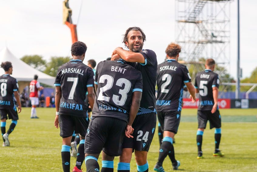 Alex De Carolis and Cory Bent celebrate Wednesday's 2-0 victoy over Valour FC in Charlottetown. Both players scored their first-ever goals for HFX Wanderers FC in the win. (CANADIAN PREMIER LEAGUE)