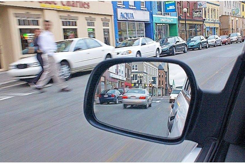 Telegram file photo<br />Pedestrians cross Water Street in downtown St. John's. <br /><br />