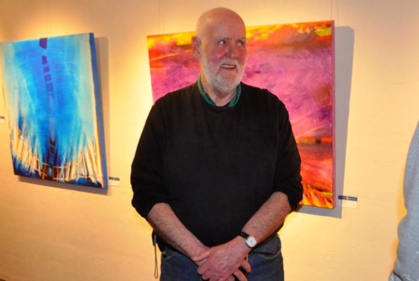 Artist Wayne Boucher connected with many members of the public at his exhibition opening at Harvest Gallery in Wolfville.