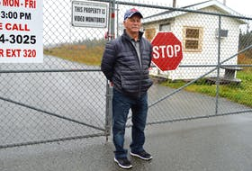 Claude Peach of Long Beach Road in Port Morien, stands at the gates to the idle Kameron Collieries owned Donkin Mine. CAPE BRETON POST