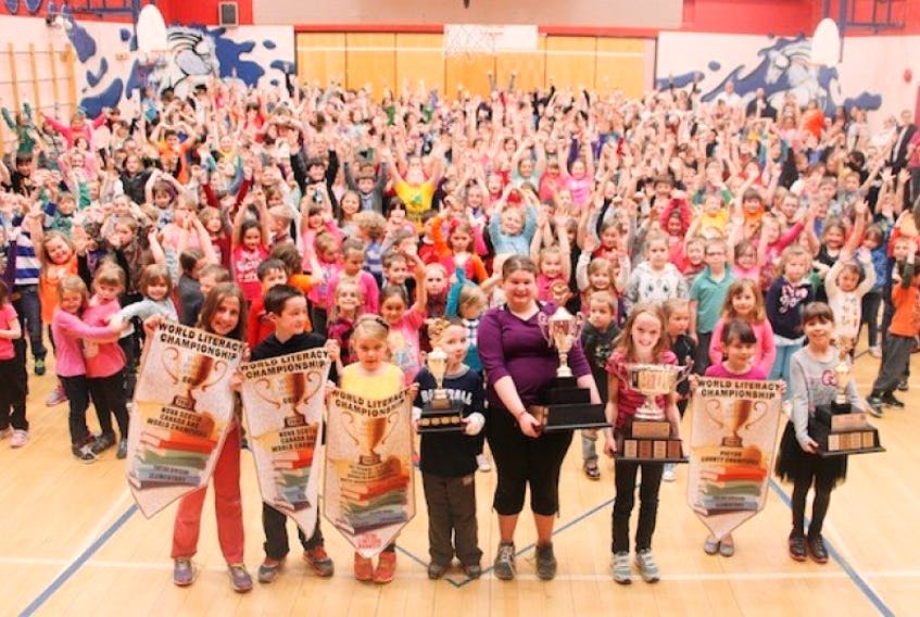<p>Students at Walter Duggan Elementary School celebrated being World Literacy Champions Friday for the WOW Reading Challenge. Over a period of six years, students at the school read one million books. Here, holding the trophies and banners, are from the left: Jordyn Ferguson, Luke Avery, Sarah Hodgson, Nathan Redding, Natalyah Allan, Kate Koch, Danica Bellefontaine and Elara Ehler. Sueann Musick – The News</p>
