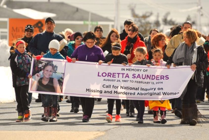 More than 100 people march in a vigil in memory of murder victim Loretta Saunders during an event at the Membertou Trade and Convention Centre Sept. 24, 2017.