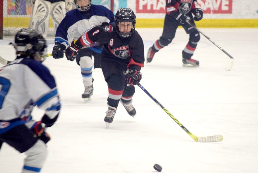 Cole Pugsley of the Truro Bearcats chases down a puck during the provincial atom A final at the Hockey Nova Scotia Day of Champions on April 13.
