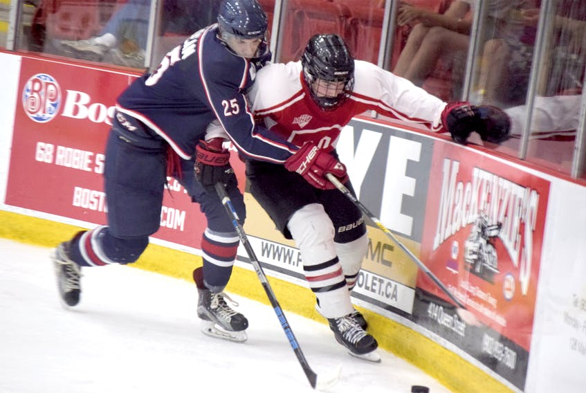 Lucas Parsons of the Truro Bearcats works hard along the boards to keep the play alive during MHL pre-season action on Aug. 31 in Truro. Parsons, the team's second-round pick from last June's draft, scored once to help the Bearcats earn a 7-2 win over the South Shore Lumberjacks.