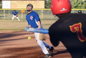Rene D'Entremont of Guysborough Transfer delivers a pitch to Brookfield Elks batter Jeremy Locke during Shooters Bar and Grill Fastpitch League action on Thursday, Aug. 20. The teams split a doubleheader at Elk Park, as Brookfield won the first game 8-1 before Guysborough bounced back for a 3-2 victory in the nightcap.