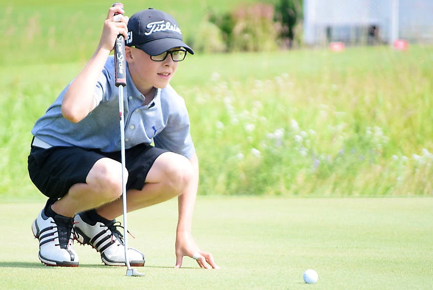 Truro's Zach Gaudet eyes up a putt during the final round of the NSGA peewee boys championship on Wednesday. Zach fired a two-day total of 8-over-par 152 to win the title.
