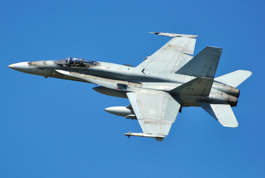 Canadian Forces CF=18 Hornet completes one of several flypasts at CFB Trenton before landing.