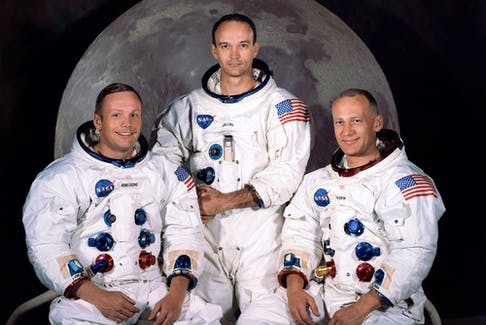 """In this file photo obtained from NASA, shows the official crew portrait of the Apollo 11 astronauts taken at the Kennedy Space Center on March 30, 1969, of(L-R) Neil A. Armstrong, Commander; Michael Collins, Module Pilot; and Edwin E. """"Buzz"""" Aldrin, Lunar Module Pilot."""