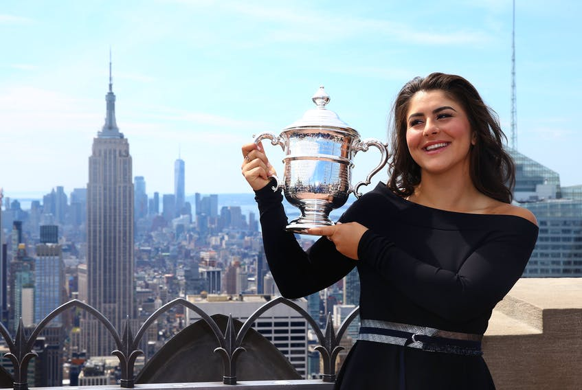 Bianca Andreescu of Canada poses with her trophy at the Top of the Rock in Rockefeller Center on September 8, 2019 in New York City.