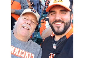 Dave Snook had a passion for football, and on occasion would travel to the U.S. for NFL action, including this 2015 game in Cincinnati with his son JD.
