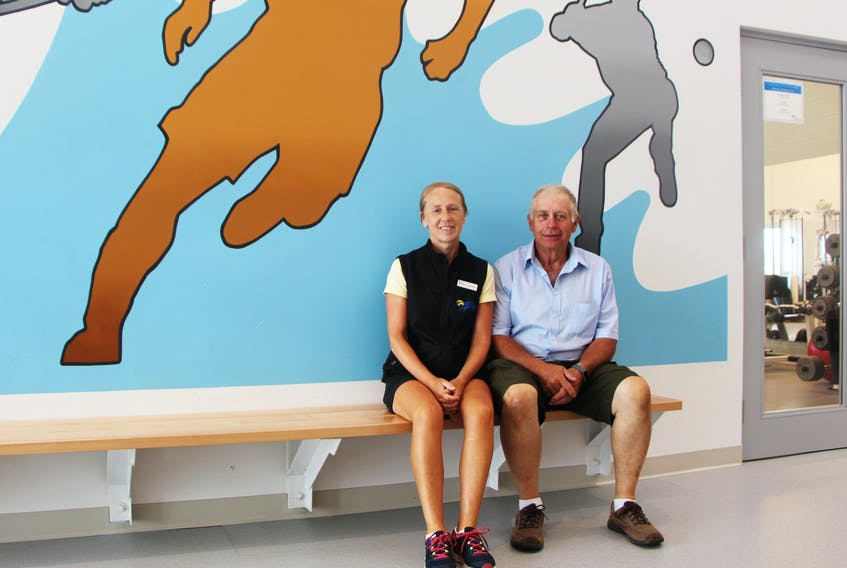 Fred Sullivan and his personal trainer Rhonda Lombardo are pictured near the fitness room at the Chedabucto Lifestyle Complex, Aug. 18. After joining the fitness centre and working with Lombardo on a 12-month plan, Sullivan lost more than 84 pounds and has now started a new plan to drop the other 16 pounds from his original goal, while adding muscle mass.