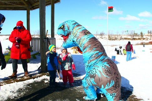 Children were excited to see dinosaurs in downtown Windsor in February. The inflatable prehistoric beasts roamed the grounds at various winter carnival events. JIM IVEY