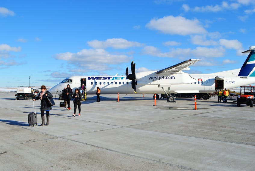 A WestJet plane at the JA Douglas McCurdy Sydney Airport earlier this year. WestJet has announced they will be starting to issue refunds for flights cancelled from the onsight of the pandemic, as of Nov. 2. Sharon Montgomery-Dupe/Cape Breton Post