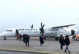Passengers disembark from a WestJet Encore plane at the JA Douglas McCurdy Sydney Airport at an earlier date. West Jet announced Wednesday they will be resuming flights to four airports in the Atlantic provinces – including Sydney – in June, as well as Quebec City. CONTRIBUTED JA DOUGLAS MCCURDY SYDNEY AIRPORT