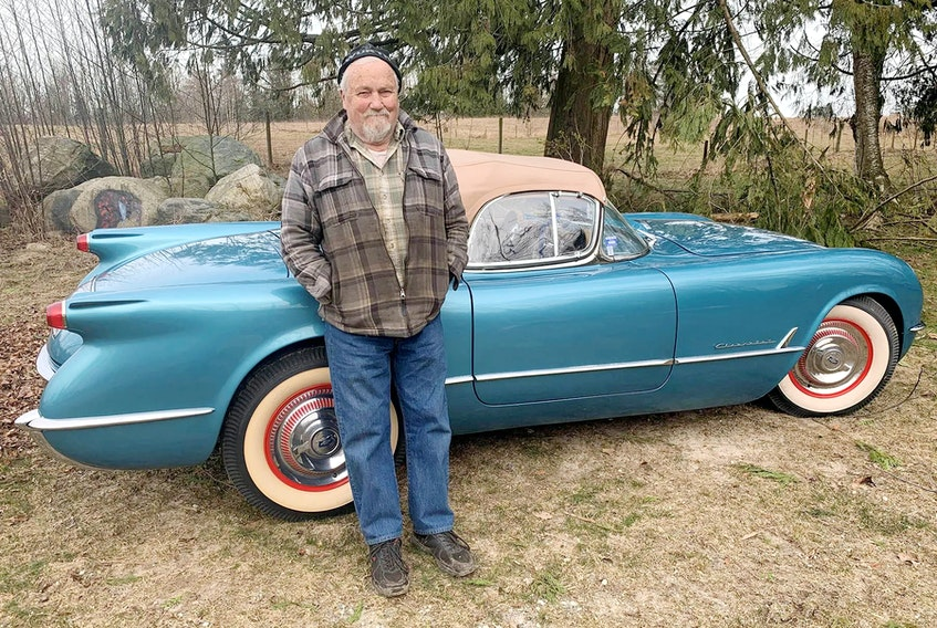 Corvette enthusiast Bob McCoy with the show winning 1954 model he restored from the ground up. Alyn Edwards photo