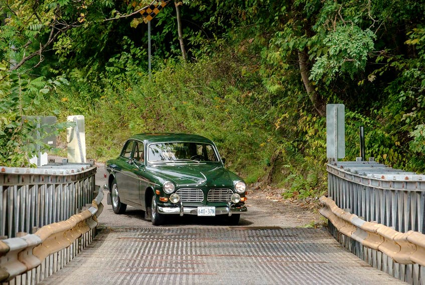 With a degree in history and a passion for heritage, Neville Britto often drives his 1968 Volvo 122S to various historic bridges and buildings around Ontario.  Clayton Seams/Postmedia News