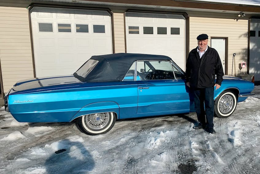 Mike Schmidt picking his 1966 Thunderbird up at the restoration shop on Christmas Eve. Alyn Edwards photo