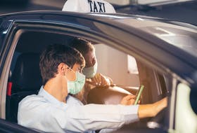 Taxi and Uber drivers still need to carry passengers, so how can they do so most safely. 123rf stock photo