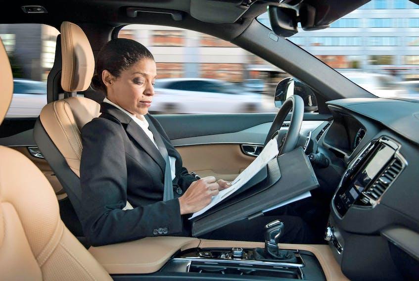 A woman reading inside an autonomous driving Volvo. Volvo/Handout