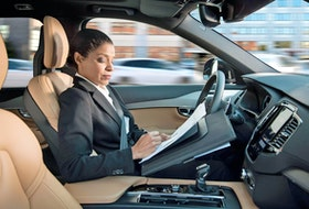 A woman reading inside an autonomous driving Volvo. Volvo/Handout